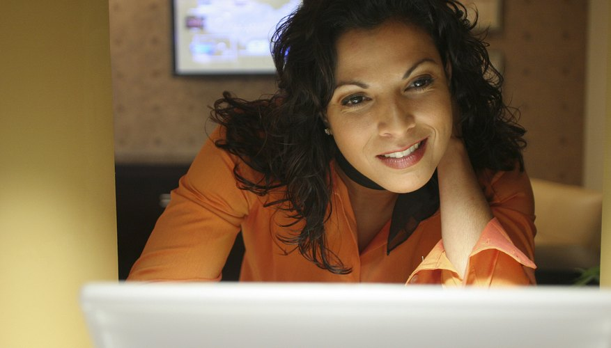 Close-up of a businesswoman working on a laptop