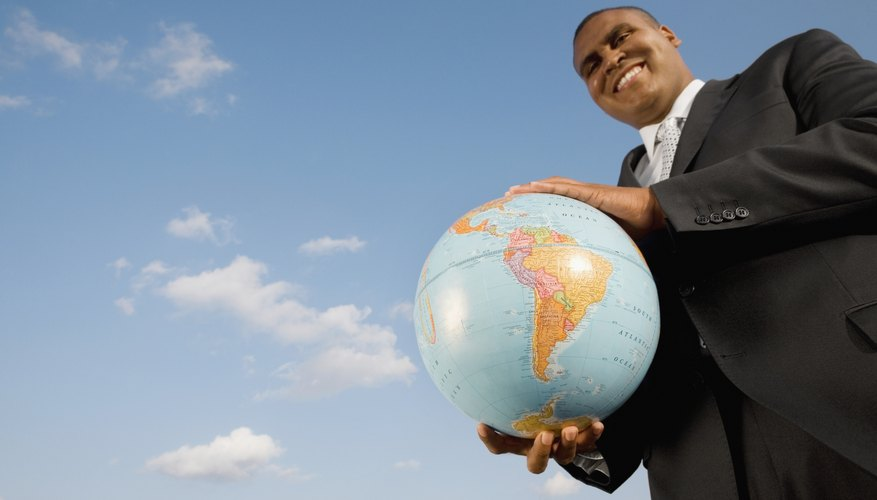 African businessman holding globe