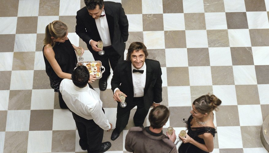 People in formal attire, holding champagne glasses, elevated view