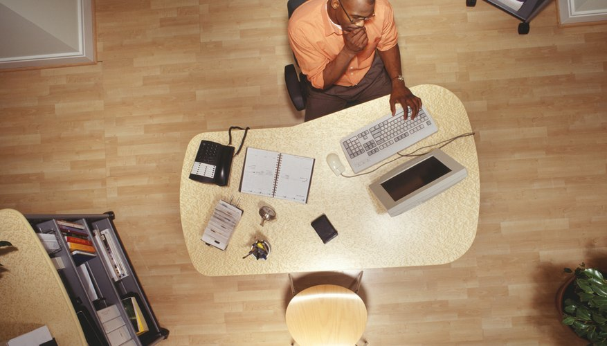 Man working on computer in office, overhead view