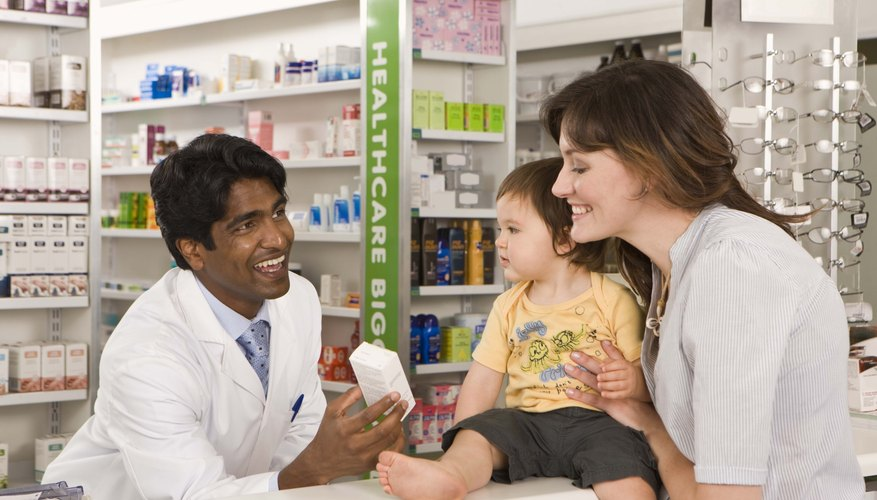 Mother and son with pharmacist
