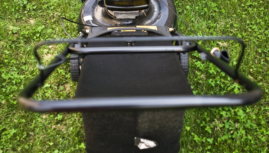 Small wheels contribute to a standard mower's instability on a slope.