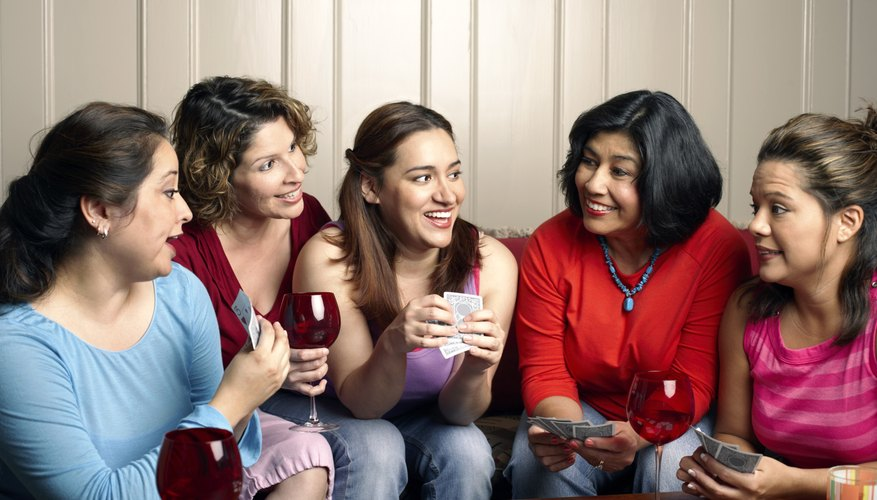 Friends playing a game and drinking wine