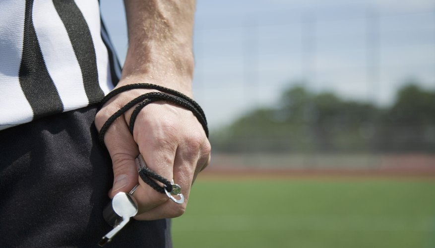 High school football referees are responsible for purchasing their own equipment, such as whistles, shirts and shoes.