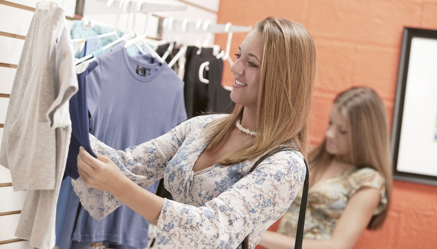 Teenagers shopping for clothes