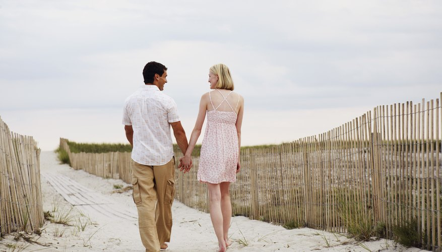 Charm your date with a romantic walk along the beach.