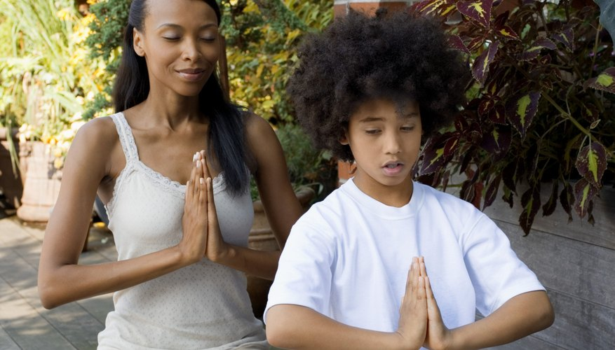 Meditate with your child to help him stay focused.