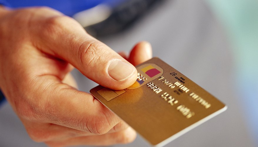 Using a credit card wisely can improve credit scores.