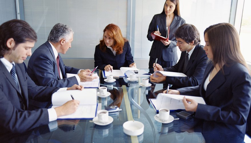 Business colleagues gathered around a conference table.