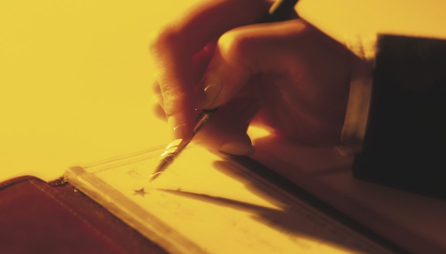 Businessman writing checks
