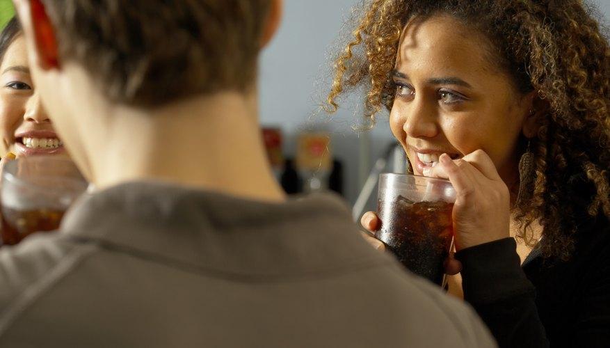 Smiling and having soda