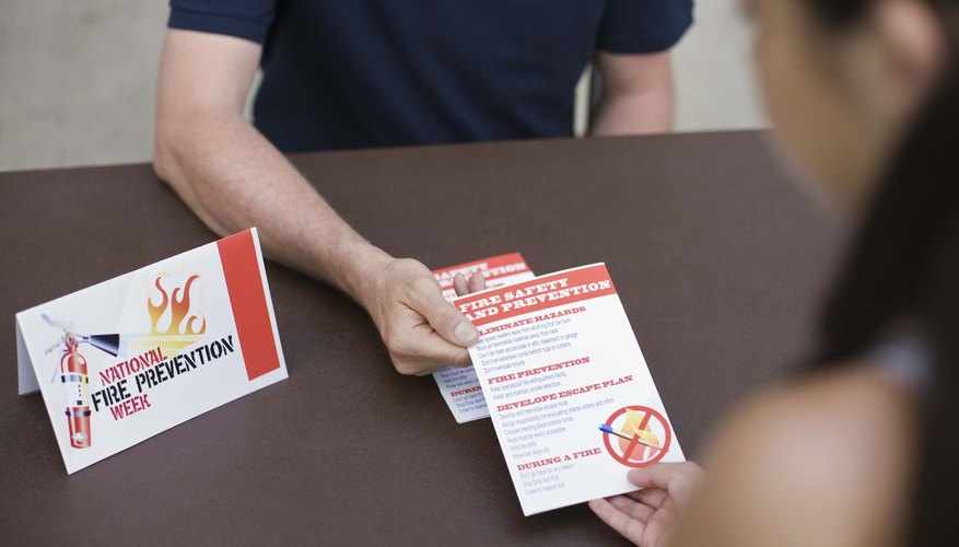 Man handing out fire prevention pamphlets