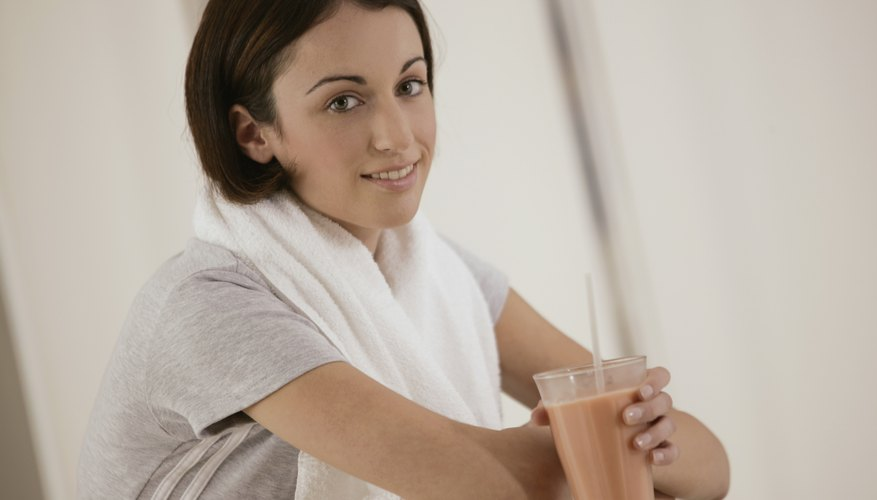 Young woman drinking a Herbalife shake