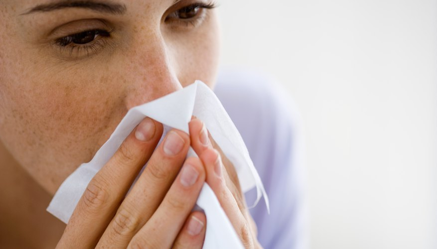 woman with sneezing allergies