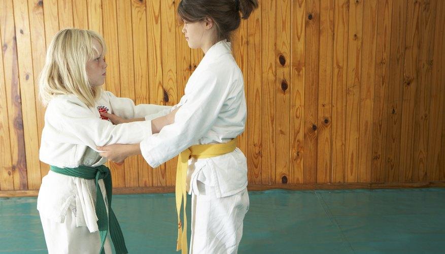 Two girls practice karate