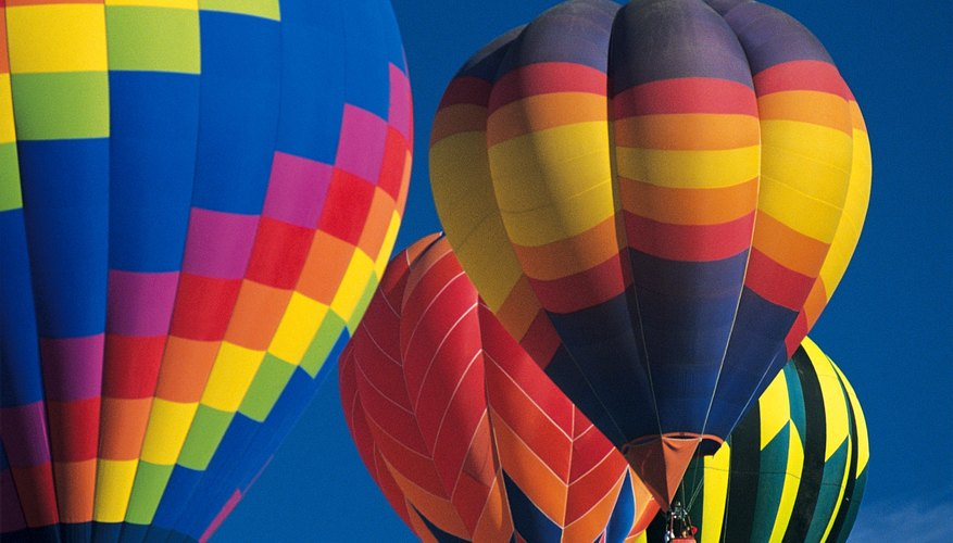 Hot air balloons float in the cooler and more dense air.