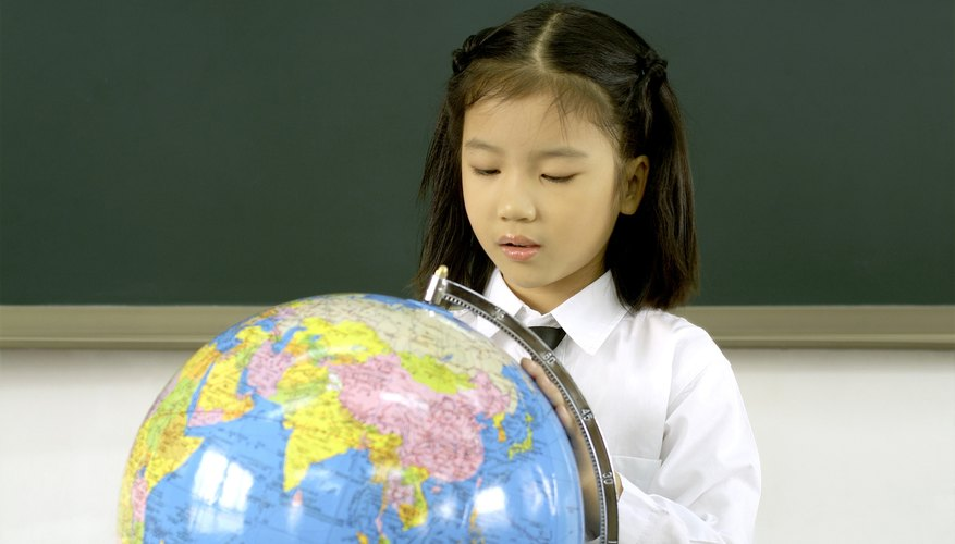 Young student looking at a globe