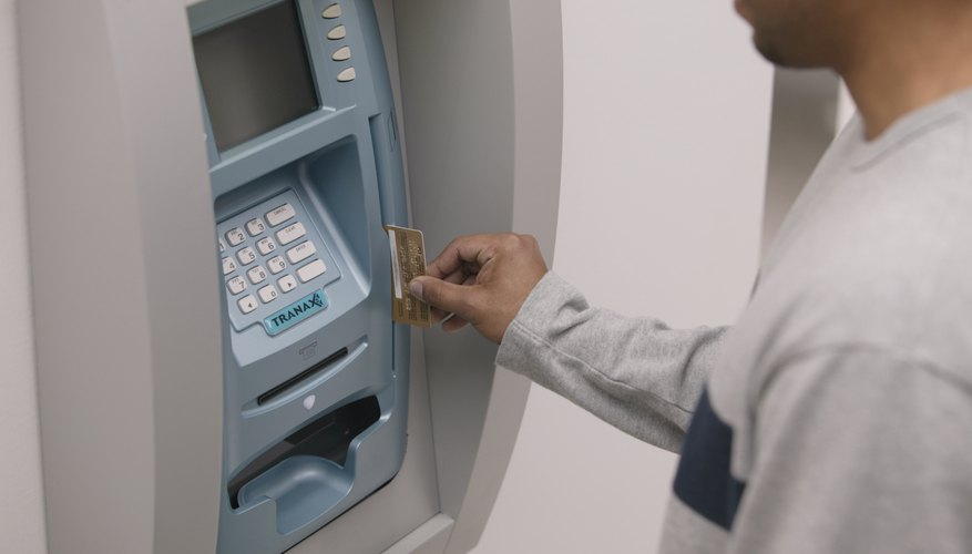 Man using an automatic teller machine.