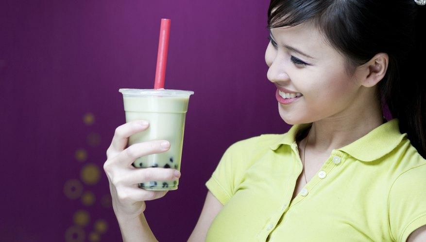 beautiful girl smiles beside the bubble tea