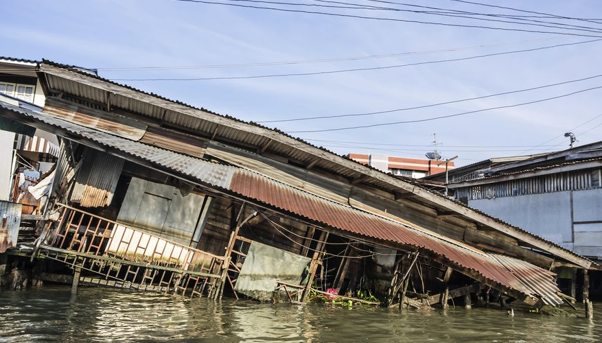 A tsunami has damaged and flooded a house.