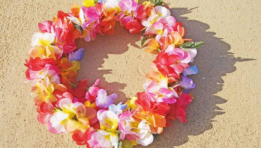 A bright lei on the sand.