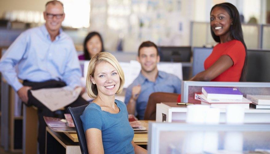Portrait Of Businesspeople In Modern Open Plan Office