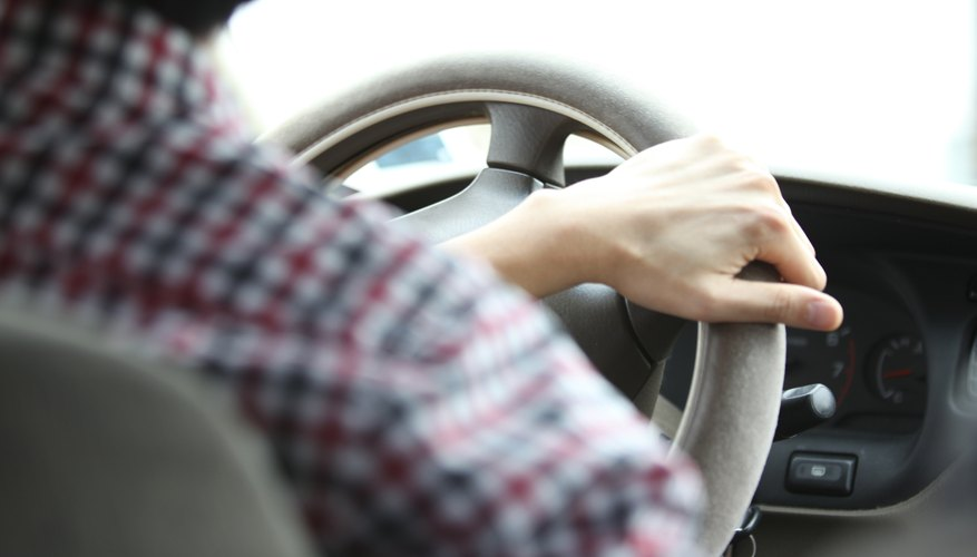 Driver with hand on wheel