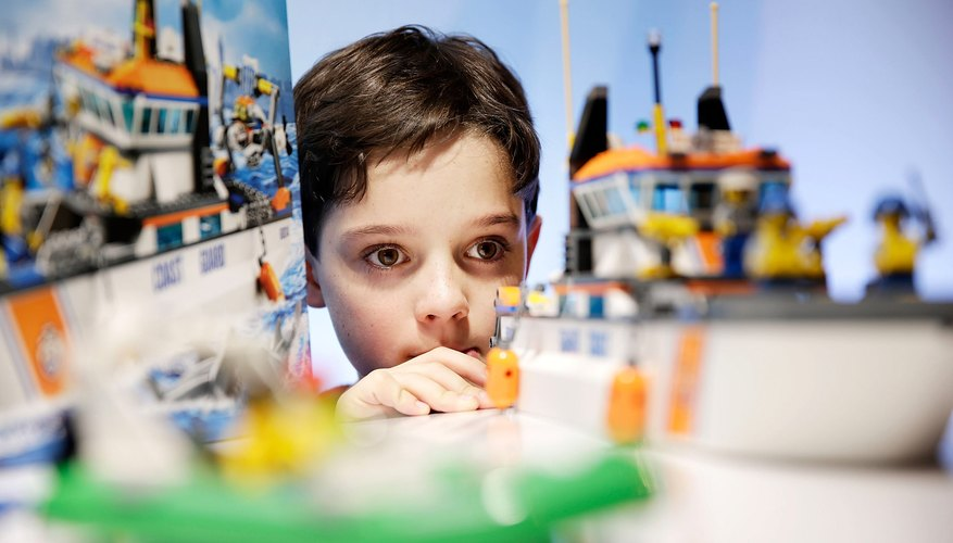 Child plays with LEGO Coast Guard Patrol in store