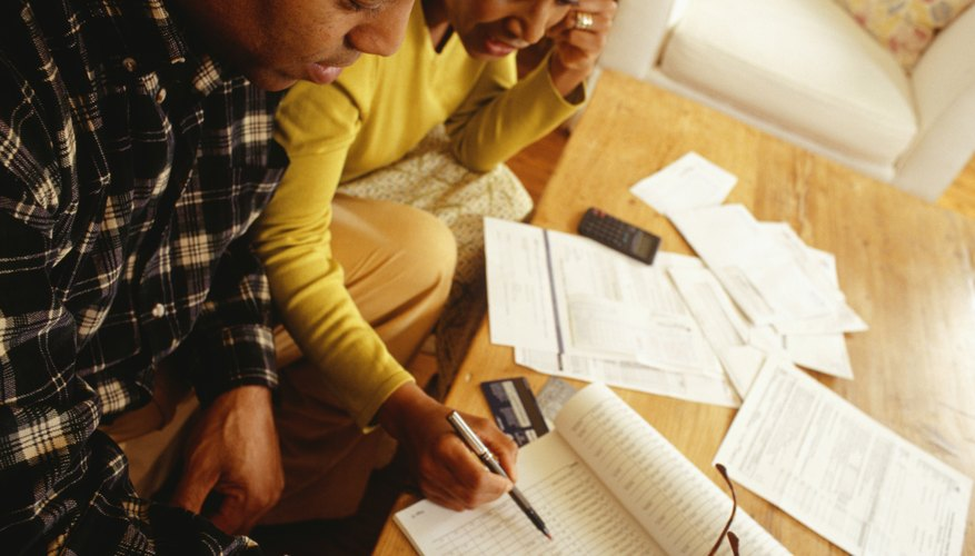 Couple managing finances in living room, elevated view