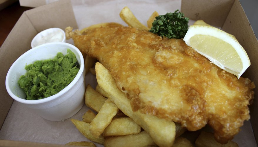 Fish and chips (cod) in box with peas, tartar sauce