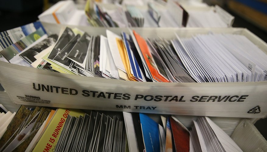 U.S. Post Service Handles Increased Delivery Load For Holiday Season