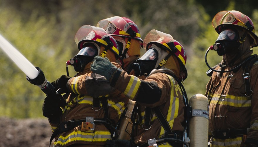 Several firefighters must hold a hose when water is sprayed.