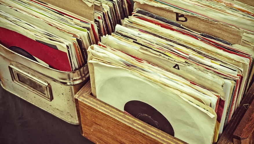 Vinyl 45s in wooden crates at a flea market.