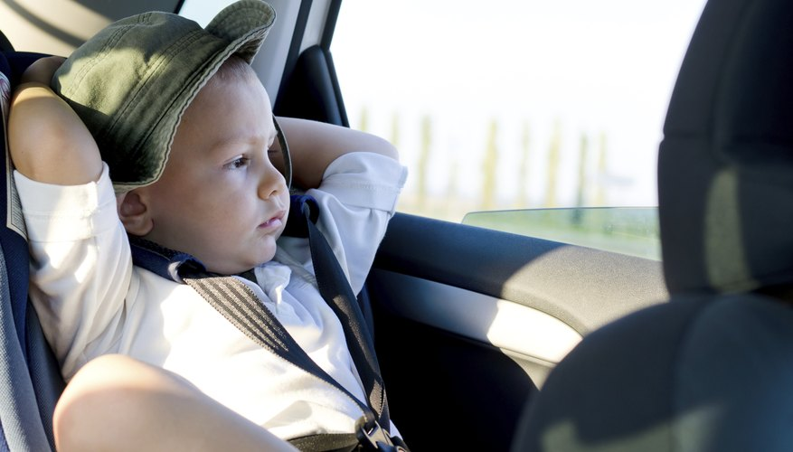 child sitting in car booster seat