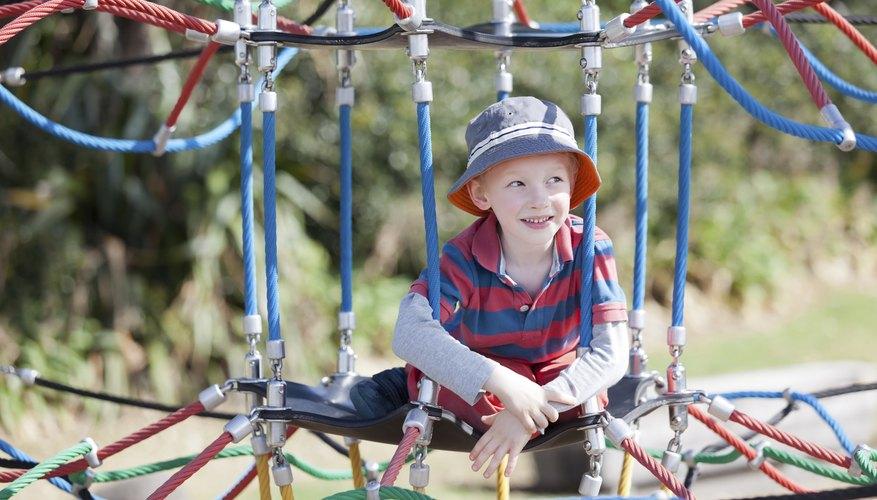 Child sitting on playground equipment