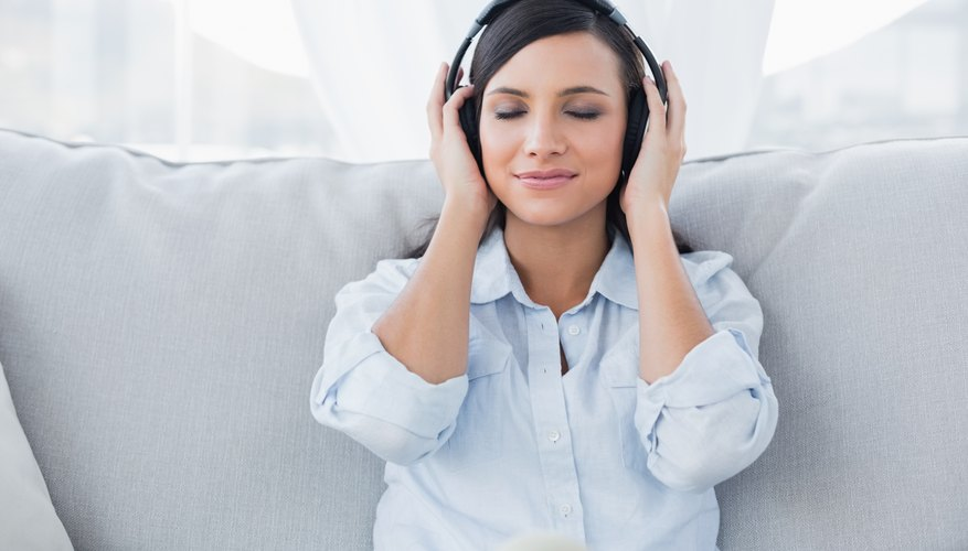 A lady is listening to music.