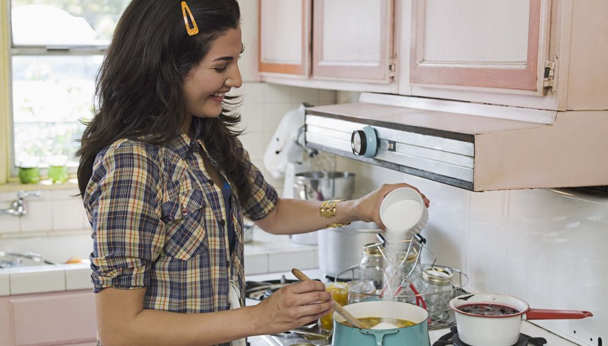 Woman baking over stove