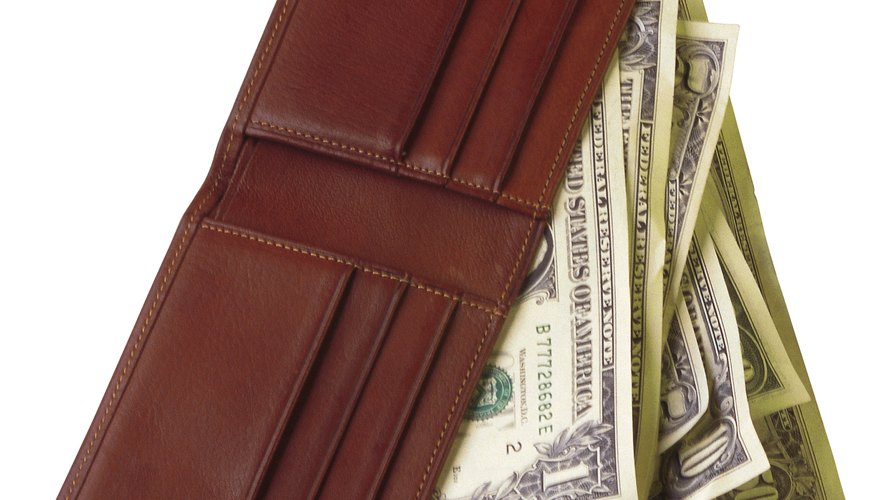 The stacked pieces of leather provide a place to put credit cards.