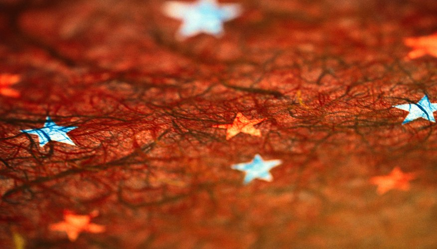 Choose tissue paper in fall colors to make a hibernation collage.