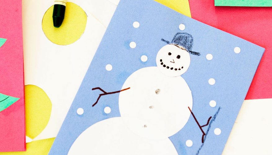 Attach your toddler's paper snowman to a card to make a holiday greeting.