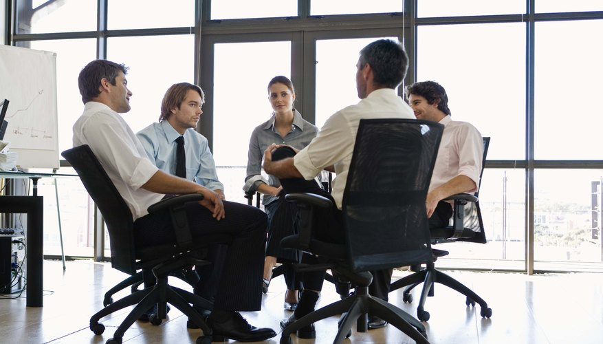 Businesspeople sitting in a circle