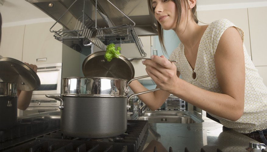 Woman steaming broccoli