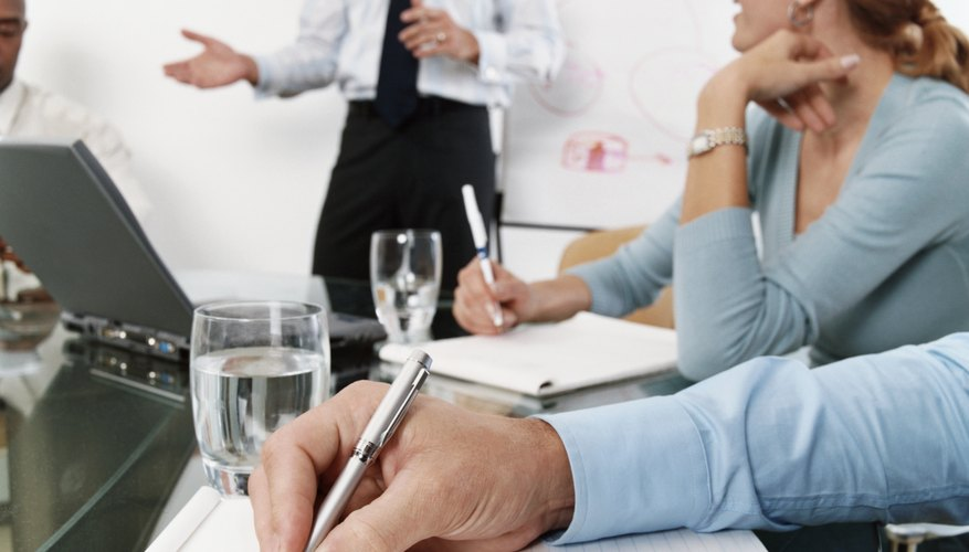 Business Executives Taking Notes in a Meeting