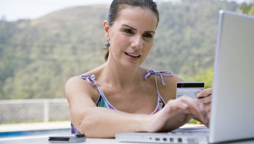 Woman using credit card online