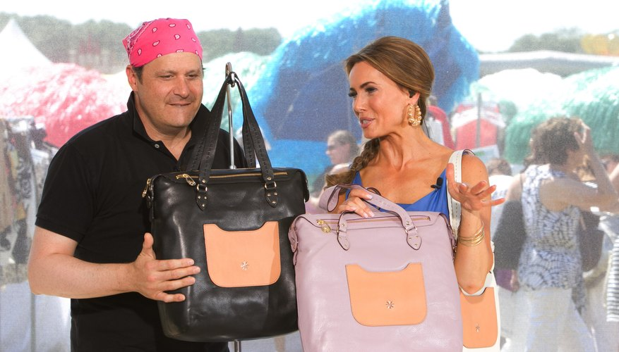 Host Lisa Robertson with guest Isaac Mizrahi on a 2011 QVC program.