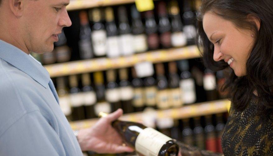 Wine shop employee with customer