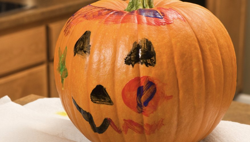 Paint a pumpkin with your toddler for a fun Halloween activity.