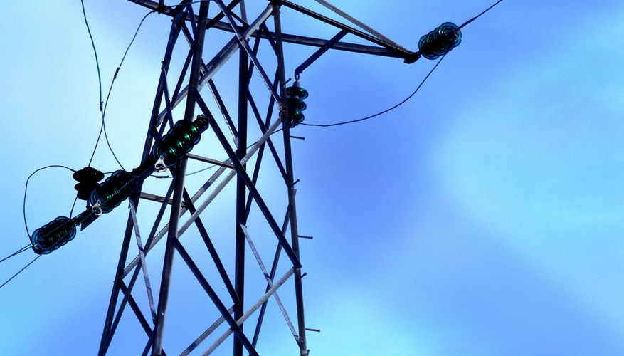 Low angle view of high tension wires across a pole