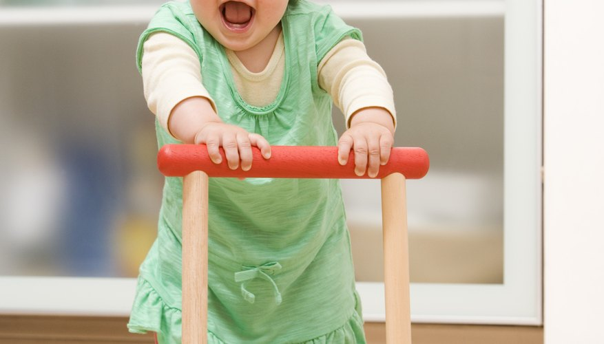 Pushing toys help build strength in the arms and back.