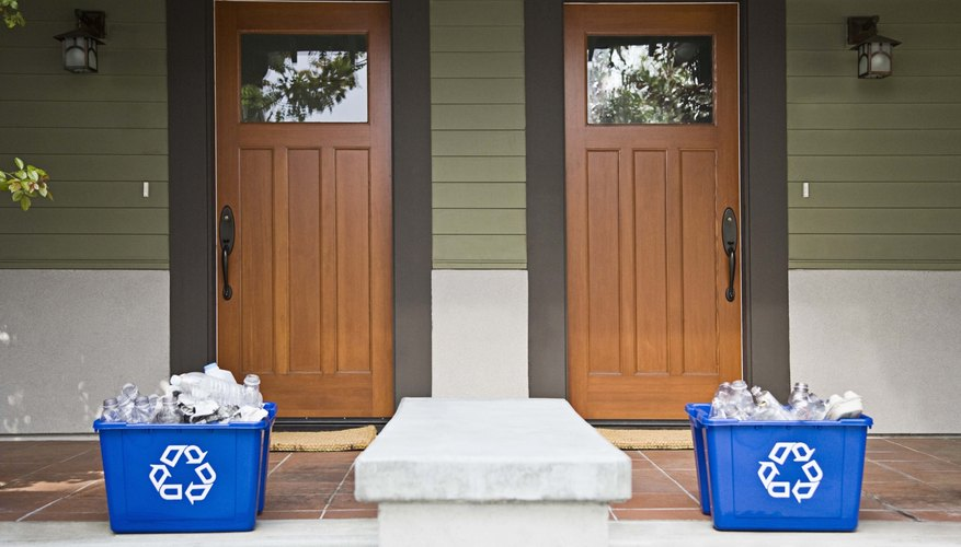 Recycling bins sit outside two homes.